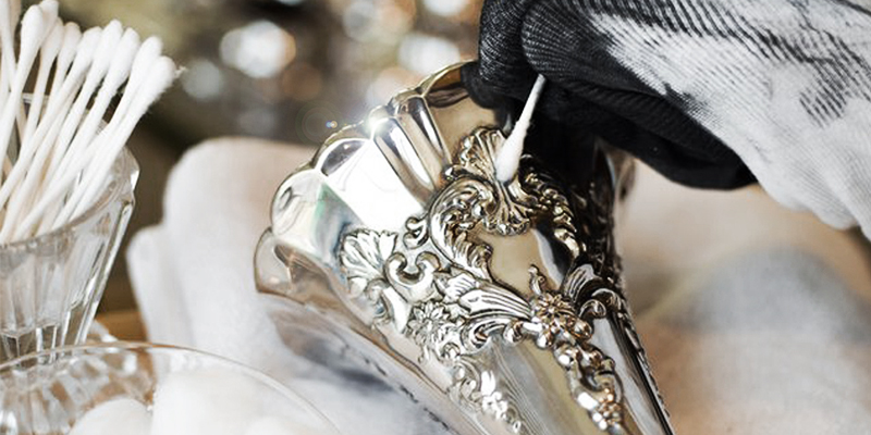 image of a person polishing silver with a cloth