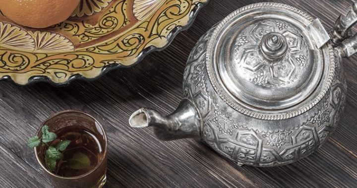 image of someone pouring tea out of a silver teapot